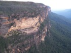 Cliffs, eucalyptus trees and blue haze common in the blur mountains.
